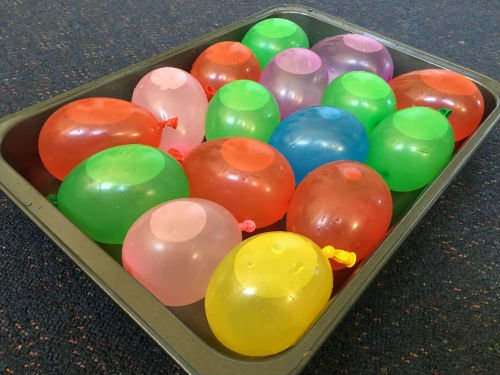 Water bombs for a STEM challenge in a baking tray