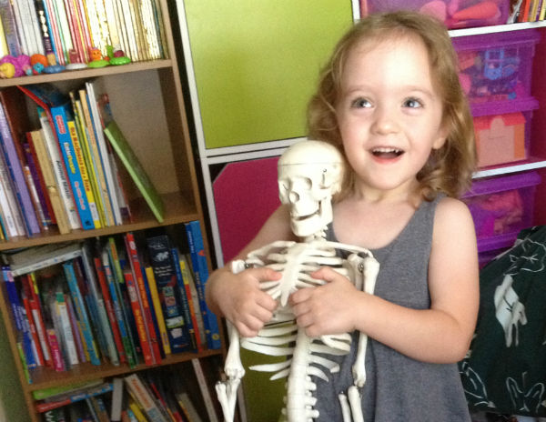 Girl holding skeleton