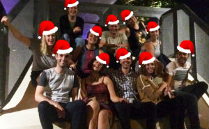 Fizzics team sittig down with Santa hats on for the 2015 christmas party in Sydney