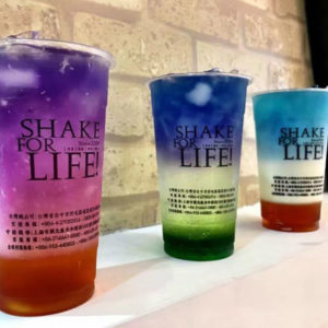 Ding tea butterfly tea, 3 plastic clear cups, from top to bottom purple pink red, blue white green, light blue white red.