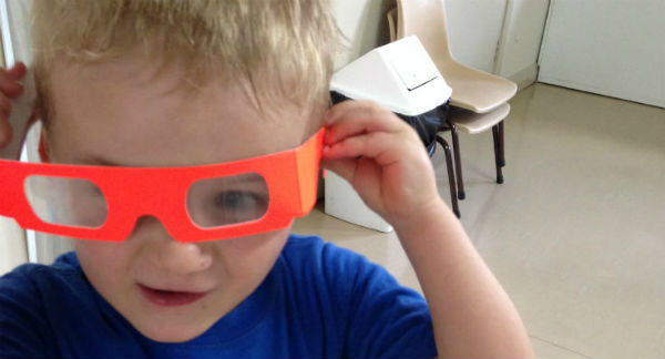 Preschooler with fireworks glasses