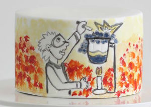 Scientist party cake wear the white cake has a scientist in full PPE adding chemicals to a bubbling beaker