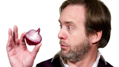 Sean Elliot holding half a red onion