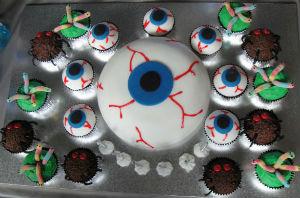 Eyeball cake surrounded by eyball cupcakes