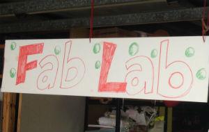 Fab lab sign in a garage